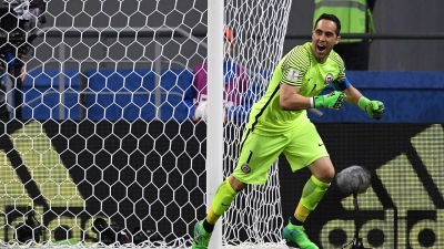 Chile's goalkeeper Claudio Bravo celebrates after Chile won the 2017 Confederations Cup semi-final football match in a penalty shoot out against Portugal at the Kazan Arena in Kazan on June 28, 2017. Kirill KUDRYAVTSEV / AFP