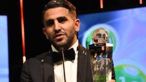 Algerian and Leicester forward Riyad Mahrez holds a trophy after being crowned African Footballer of the Year in Abuja, on January 5, 2017. Algerian and Leicester striker Riyad Mahrez has been crowned the CAF African best Footballer for 2016 and beating former best player and Gabonese forward Pierre-Emerick Aubameyang and Sehegalese striker Sadio Mane, for the continent's most prestigious individual award.