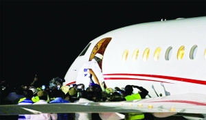 •GOING: Jammeh boarding the Falcon Jet on his way into exile in Equitorial Guinea...Saturday night.
