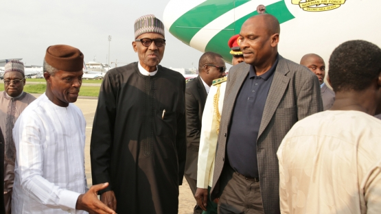 Vice President Professor Yemi Osinbajo (L) welcomes back to the country ailing Nigerian President Mohammadu Buhari in Abuja, on August 19, 2017.