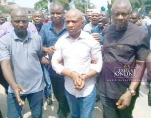 The kidnap kingpin Evan (middle) paraded at Lagos Police Command on Sunday in Lagos.