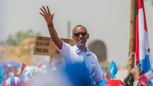 Rwandan President Paul Kagame of the ruling Rwandan Patriotic Front (RPF) waves to his supporters during his final campaign rally in Kigali, Rwanda, Aug. 2, 2017.