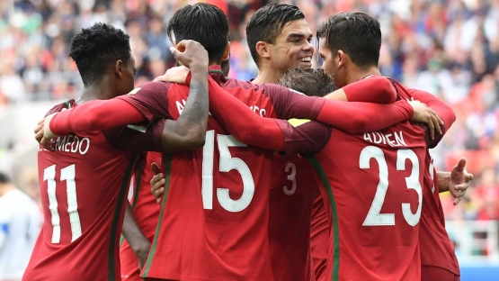 Portugal's midfielder Adrien Silva (R) celebrates with Portugal's forward Ricardo Quaresma (L) and Portugal's forward Andre Silva (C) after scoring his team's winning goal during the 2017 FIFA Confederations Cup third place football match between Portugal and Mexico at the Spartak Stadium in Moscow on July 2, 2017. Yuri KADOBNOV / AFP