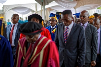 President Robert Mugabe, center, appeared on Friday, under tight security, at a graduation ceremony at a university in Harare. Credit Ben Curtis/Associated Press