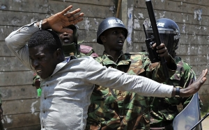 A protestor is arrested by anti-riot police September 26, 2017, in Nairobi, during a demonstration to demand the removal of officials from national election oversight body, Interim Elections and Boundaries Commission (IEBC) allegedly implicated in the manipulation of the votes tally during the August 8, presidential elections. AFP PHOTO / TONY KARUMBA