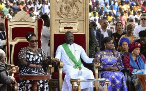 Liberia's President-elect and former football star George Weah (C), the country's former President Ellen Johnson Sirleaf (R), the country's new Vice-President Jewel Taylor (L) and Weah's wife Clar Weah attend Weah's swearing-in ceremony on January 22, 2018 in Monrovia. To the cheers of a crowd fired by his promise to bring them jobs and prosperity, former football star George Weah was sworn in as president of Liberia on January 22, completing the country's first transition between democratically-elected leaders since 1944. / AFP PHOTO / ISSOUF SANOGO