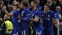 Chelsea's Spanish striker Alvaro Morata (2L) celebrates scoring the opening goal with teammates during the English Premier League football match between Chelsea and Manchester United at Stamford Bridge in London on November 5, 2017. Adrian DENNIS / AFP