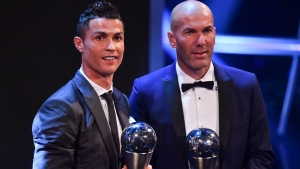 Real Madrid's French coach Zinedine Zidane (R) stands with his trophy for winning The Best FIFA Men's Coach of 2017 Award alongside Real Madrid and Portugal forward Cristiano Ronaldo, with his trophy for winning The Best FIFA Men's Player of 2017 Award during The Best FIFA Football Awards ceremony, on October 23, 2017 in London. Ben STANSALL / AFP