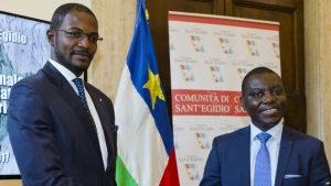 CAR Foreign Minister Charles Armel Doubane, right, and Armel Mingatoloum Sayo, head of the Revolution and Justice militia, mark the signing of a Central African Republic peace accord at the Sant'Egidio headquarters in Rome, June 19, 2017. Members of 13 Central African Republic's militant groups signed a preliminary agreement to stop the civil war, reaffirm the unity of the country, and the respect of human and civil rights.