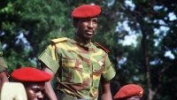 (FILES) This file photograph taken on August 4, 1985, shows then President of Burkina Faso Captain Thomas Sankara, as he reviews troops in a street of Ouagadougou, during celebrations of the second anniversary of the Burkina Faso's revolution. Sankara was killed in October 1987, in a coup d'etat in which President Blaise Compaoré, his former comrade-in-arms, took power. In 1983, Compaoré helped his boyhood friend seize power from then President Jean-Baptiste Ouedraogo. After years of silence on the case, a court is set to re-launch the investigation into the assassination of Thomas Sankara, the father of the Burkinabe revolution killed during the October 1987 coup d'état. / AFP PHOTO / DANIEL LAINE