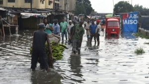 Torrential rainfall left many homes, shops and roads flooded in Lagos