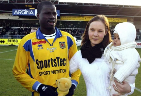 Emmanuel Eboue with wife when the going was good